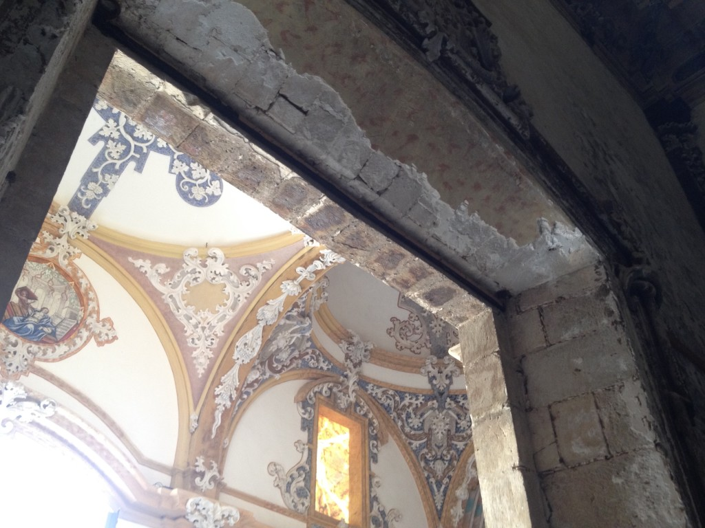 All of the vibrant colors are painted on recently-added plaster in an attempt to recreate something of what this place was centuries ago. Compare to the relatively bare stone above the doorway.